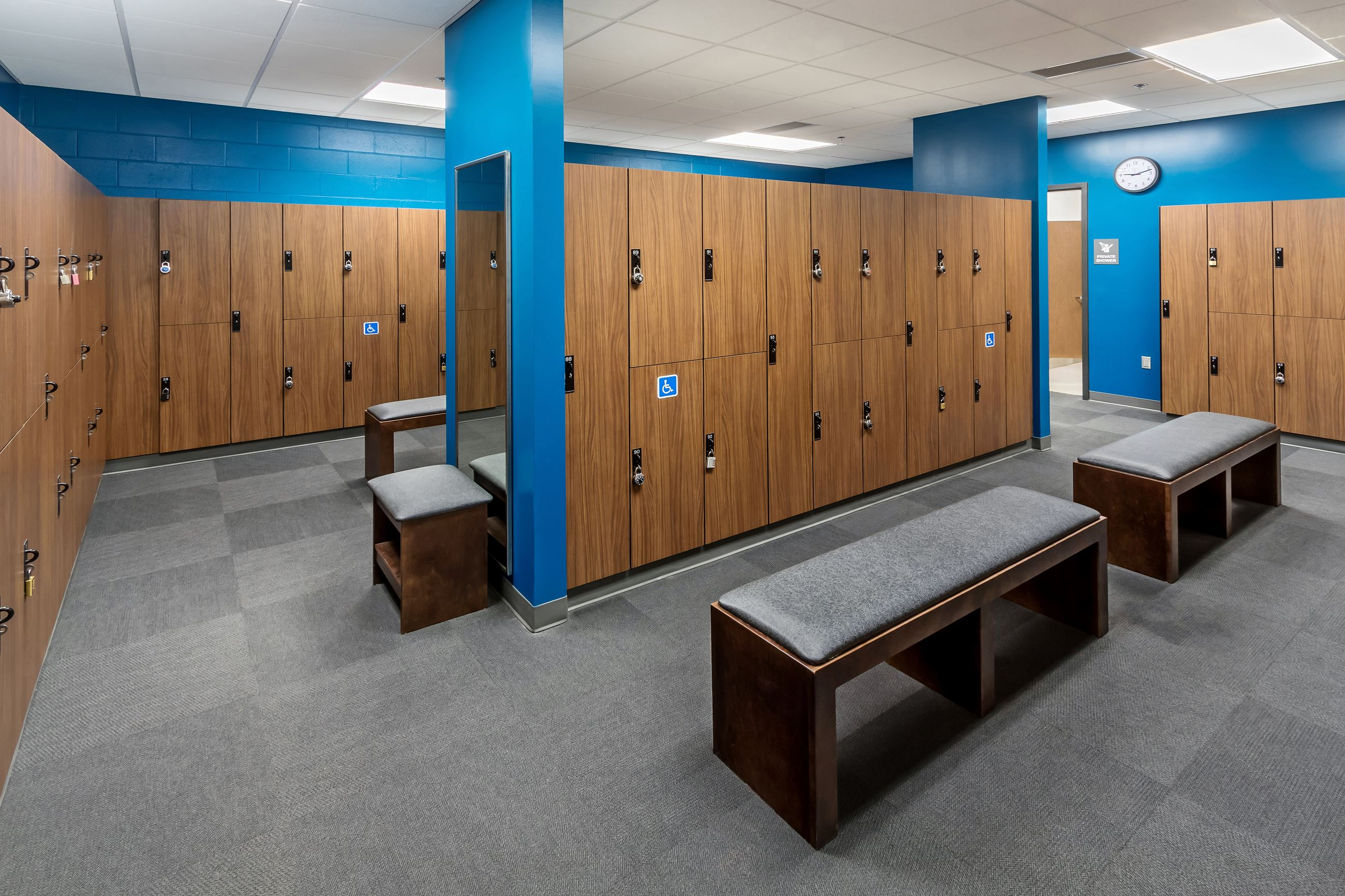 A locker room and benches in a fitness facility